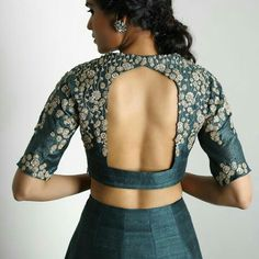 Green blouse with a cut out blouse with dull gold embroidery