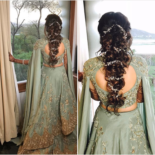 Latest blouse styles | new blouse styles to love | latest blouse designs for Indian brides | Indian bride with beautiful twisted braid with baby's breath flowers | Pale green gown with long draped floor length sleeves
