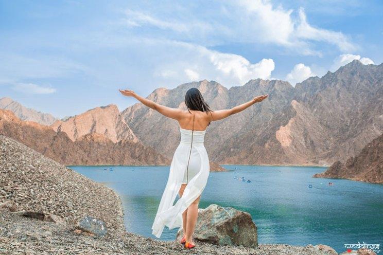 first anniversary idea, anupriya and ankit, aniversary photoshoot | Indian girl in a white dress near Dubai palm water