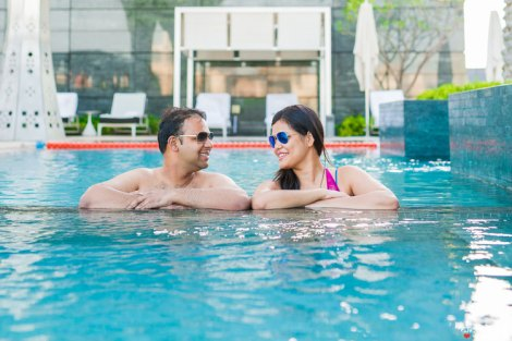 first anniversary idea, anupriya and ankit, aniversary photoshoot | Indian couple photoshoot n the swimming pool wearing shades