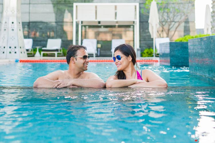 first anniversary idea, anupriya and ankit, aniversary photoshoot   Indian couple photoshoot n the swimming pool wearing shades