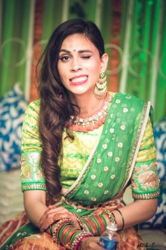 JyotPriya and Nishant | Punjabi wedding in Delhi | The bride giving quirky poses on her Sangeet.