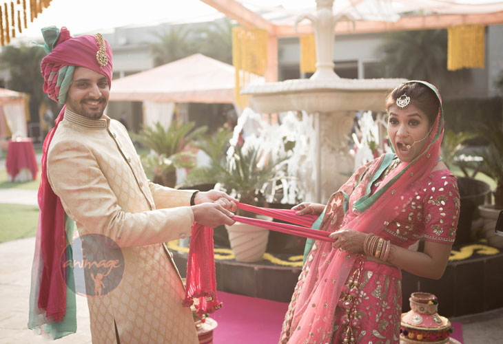 Anukriti and Siddharth | Delhi Wedding full of simple nd fun wedding ideas | Photo by AnImage Productions | Indian couple cute poses on the wedding day | bride and groom in coordinated outfits | pink lehenga with sea blue green lining details