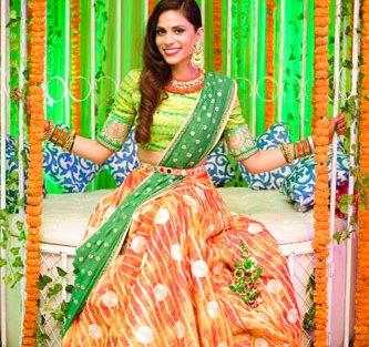 JyotPriya and Nishant | Punjabi wedding in Delhi | The bride swinging on the marigold swing on her sangeet.