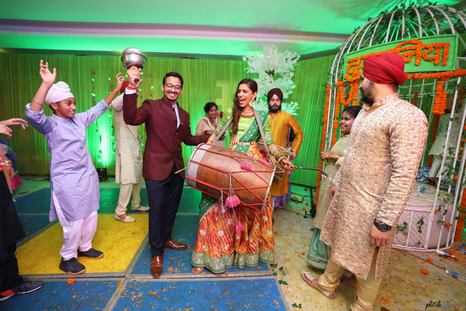 JyotPriya and Nishant | Punjabi wedding in Delhi | While the boss bride plays the dhol, the dapper groom dances on her tunes. A perfect band baaja baraat moment.