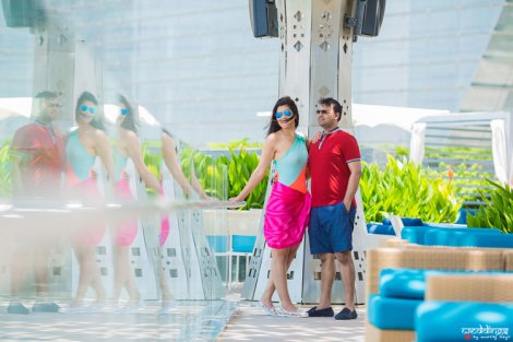 first anniversary idea, anupriya and ankit, aniversary photoshoot | Indian couple photoshoot in Dubai by the poolside in shorts and a sarong