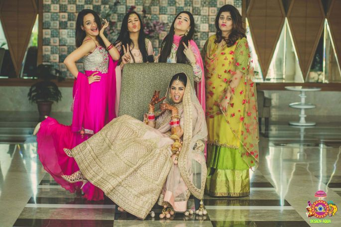 Indian bridal Photos | Delhi Wedding | Kiah and Ron | Indian bride wearing a gorgeous blush and gold lehenga posing for a selfie with her bridesmaids