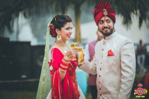 Chitrakshi and Neil | Offbeat wedding in Delhi | Day wedding full of ideas | Indian bride wearing an ivory lehenga with a floral sleeve blouse and a red and pista pastel double dupatta | Indian bride and groom drinking beer at their wedding | photo by Design Aqua | WIttyVows
