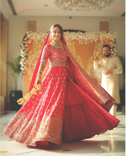 New lehenga styles, Gorgeous lehenga ideas, Unique lehengas |Indian bride wearing a pretty light red lehenga with 3 layers