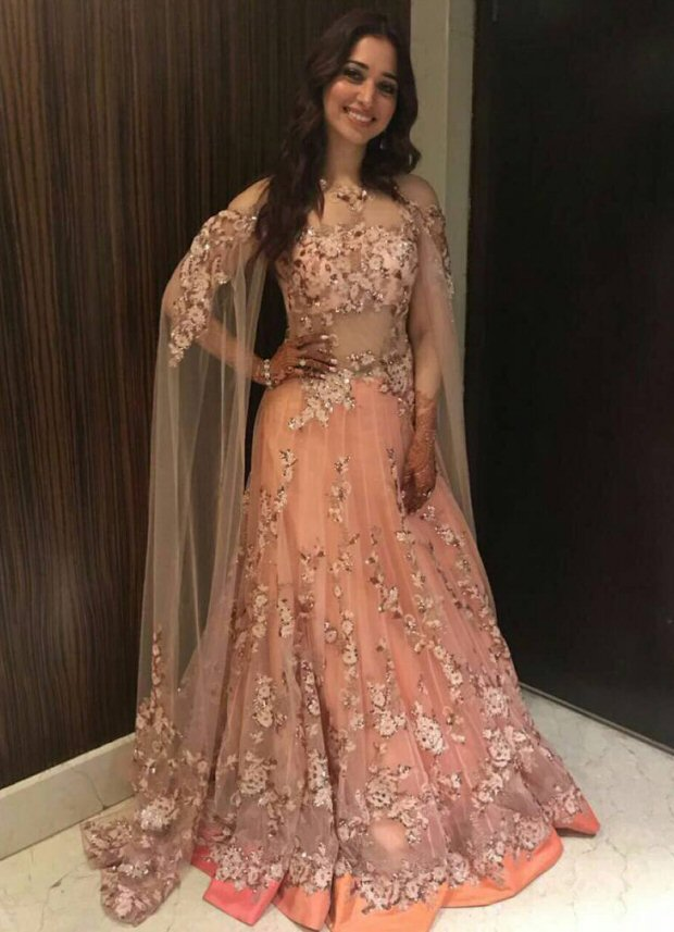 Tamannaah Bhatia at her brothers wedding in Mumbai flaunting pretty sister of the groom looks | Tamannaah Bhatia in a pretty pastel peach gown with flower work insulter by Neeta Lulla | sister of the bride looks