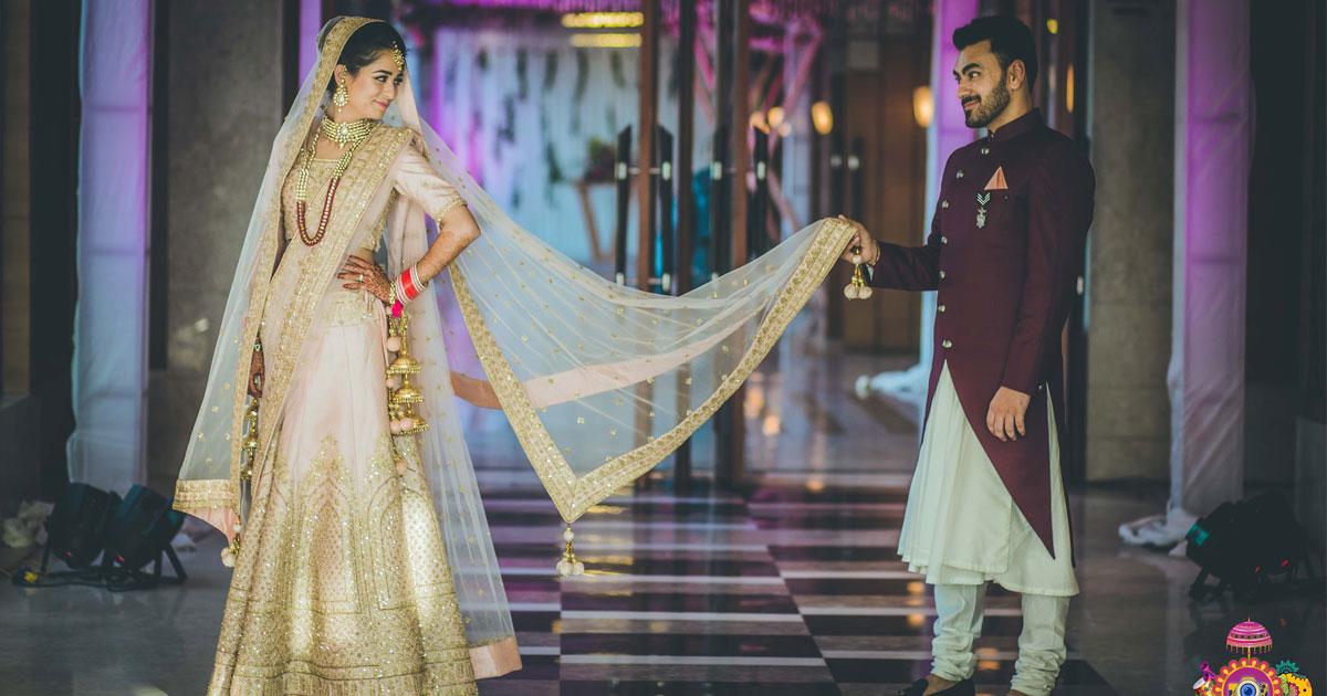 .Indian bridal Photos | Delhi Wedding | Kiah and Ron | Indian bride in a pretty blush lehenga with the groom in a marsala wine sherwani