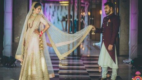 .Indian bridal Photos   Delhi Wedding   Kiah and Ron   Indian bride in a pretty blush lehenga with the groom in a marsala wine sherwani