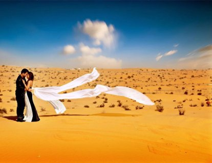 Nindiya and Nirmal | Indian bridal lehenga | Real flower lehenga | The couple giving major bolloywood scene feel with an amazing shot in the deserts of Dubai.