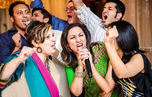 Teej party ideas   Teej Celebrations   Indian wedding guests singing kareoke