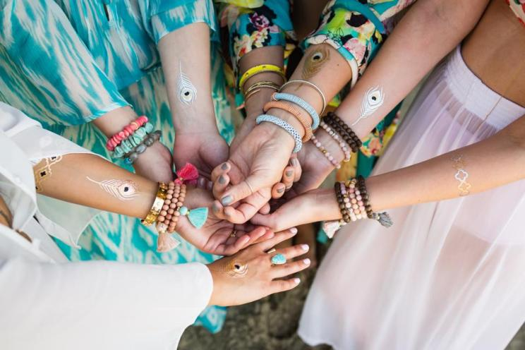 Squad accessories for Indian Weddings | Team bride metallic tattoos that you can use | Ideas for the bride's side bridesmaids | team bride tattoos | Matching peacock tatoos for all indian bridesmaids