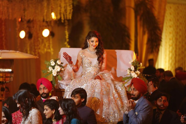 Fun Punjabi wedding ideas | Raagini and Gurtej - pretty wedding story | The bride's sangeet entry on her brother's shoulder is so cute.