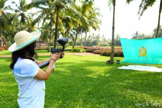 Bavleen and Kushal   Destination wedding in Goa   The wedding had various fun activities. The girl playing and aiming with a gun is one of them