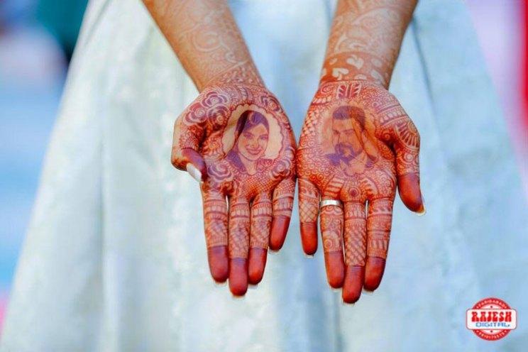 Netika and Kushank | Destination wedding in Jaipur | The portrait mehendi of the bride looks beautiful.