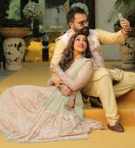 Bavleen and Kushal   Destination wedding in Goa   The groom clicks a selfie while the bride in his arms looks on.