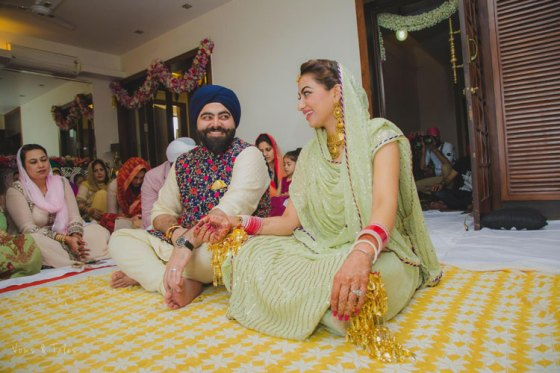 Bavleen and Kushal   Destination wedding in Goa   The bride and groom look at each other during mehendi function.
