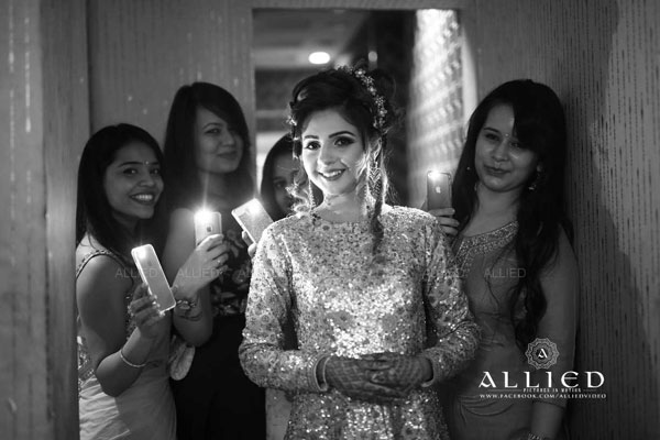 Roka ceremony in delhi, Raveena and Dipanshu   Bride with her friends holding cellphone torch lights