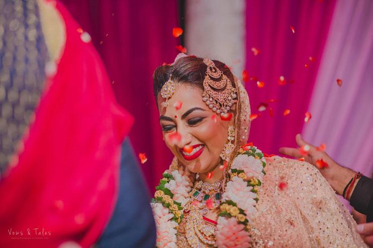 Bavleen and Kushal   Destination wedding in Goa   The bride smiling during the pheras.