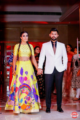Netika and Kushank | Destination wedding in Jaipur | The bride's mustard yellow outfit with rainbows and parachutes while the groom compliments her in a tuxedo looks awesome.
