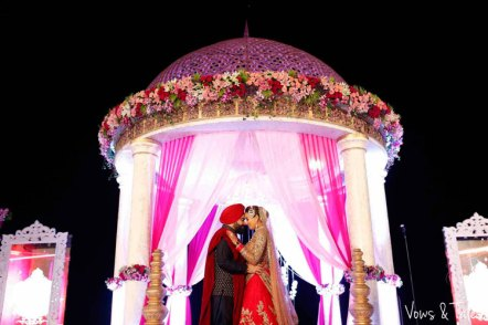 Bavleen and Kushal   Destination wedding in Goa   The bride and groom in front of the mandap sharing a cute moment.