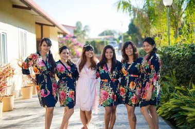 Joshua and Shona   Christian wedding   DIY ideas   The bride in a white robe posing with her girl tribe in matching robes.