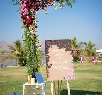 Joshua and Shona | Christian wedding | DIY ideas | The cute signage board with the wedding details along with the the pretty sterlised botles loooks so great.