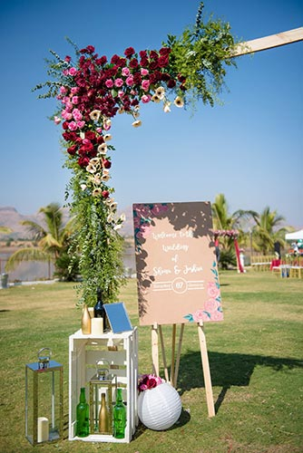 Joshua and Shona   Christian wedding   DIY ideas   The cute signage board with the wedding details along with the the pretty sterlised botles loooks so great.