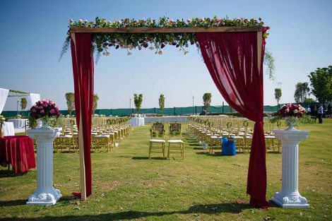 Joshua and Shona   Christian wedding   DIY ideas   The marsala curtains with white flower decor on the entry gate looks so great.
