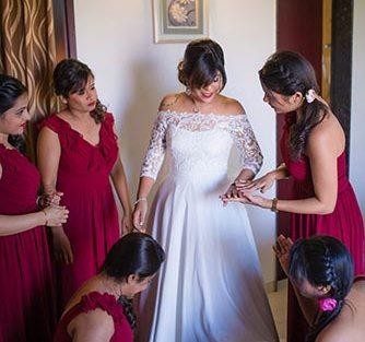 Joshua and Shona   Christian wedding   DIY ideas   The bridesmaids helping the bride get ready.