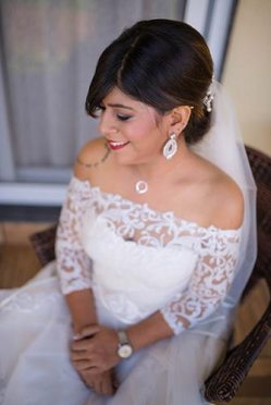 Joshua and Shona   Christian wedding   DIY ideas   The beautiful bride in an offshoulder white gown and diamond jewlry.