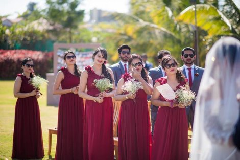 Joshua and Shona | Christian wedding | DIY ideas | The gang of girls in marsala gowns look so amazing.