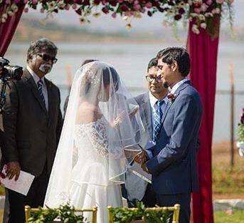 Joshua and Shona   Christian wedding   DIY ideas   The bride and groom smiling during their wedding rituals.