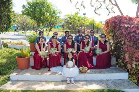 Joshua and Shona | Christian wedding | DIY ideas | The girsl in marsala gowns and boys in grey tuxedo posing together.
