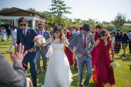 Joshua and Shona   Christian wedding   DIY ideas   The bride and groom walking with family and friends after the wedding function.