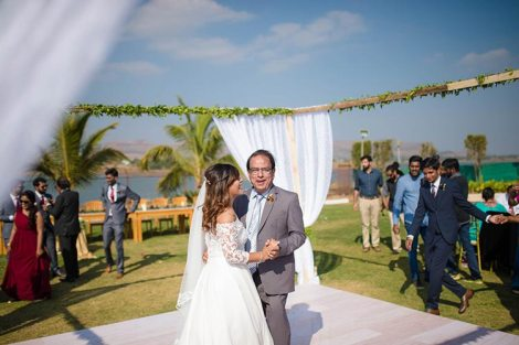 Joshua and Shona   Christian wedding   DIY ideas   The bride dancing with her father amidst the gold and white curtain on dance floor is so amazing.