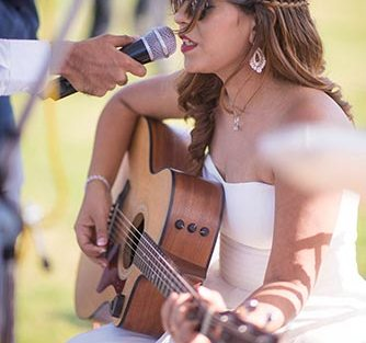 Joshua and Shona | Christian wedding | DIY ideas | The bride singing while playing the guitar.