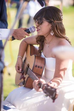 Joshua and Shona   Christian wedding   DIY ideas   The bride singing while playing the guitar.