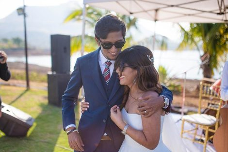 Joshua and Shona | Christian wedding | DIY ideas | The bride and the groom smiling and sharing a hug.