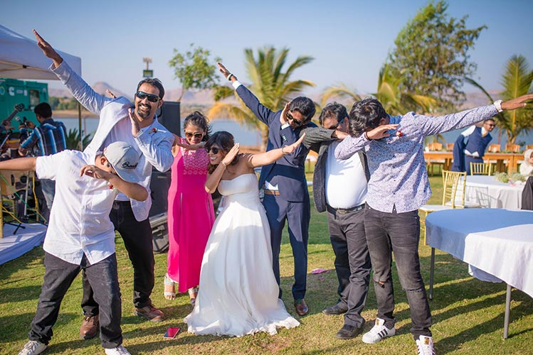 Joshua and Shona   Christian wedding   DIY ideas   The bride and groom striking a fun pose with friends.