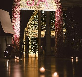 Jaya and Anish | Roka ceremony | Flower decor | The flower ladden gate with the monogram is a definite style rage.