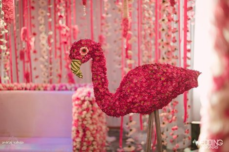 Jaya and Anish | Roka ceremony | Flower decor | The pink floral flamingo as the photobooth decor was so beautiful.
