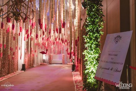 Jaya and Anish | Roka ceremony | Flower decor | The hanging pink and white flowers at the entry gate looked amazing.
