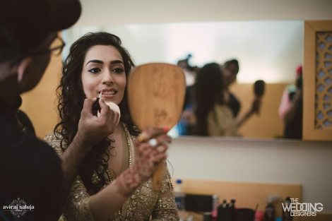 Jaya and Anish | Roka ceremony | Flower decor | The bride getting her make up done for roka ceremony.