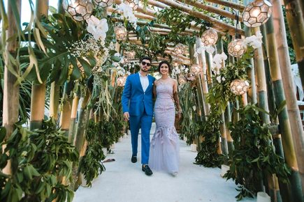 Sagar and Subiya   Destination wedding in Bali  The bride in her white gown and the groom in his blue tuxedo walking in style.