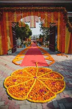 Nimisha and Hemant | Temple wedding in Delhi | The rangoli made with marigold at the temple for wedding looks gorgeous.