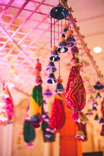 Nimisha and Hemant   Temple wedding in Delhi   The colorful hanging bells as a decor looks so amazing.